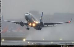 And the forecast was sunny... (zoomerphil) Tags: london gatwick lgw boeing 737 738 737800 fly flight passenger plane aeroplane jetplane b737 b738 rain wet spray runway takeoff