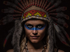 The native american convert (Tommy Hyland) Tags: blue portrait people woman white sexy girl beautiful beauty face look smiling coral closeup female youth race dark hair fur happy person one necklace costume model paint pretty colours mask eagle serious native indian traditional decoration young feather adorable makeup charm flute tribal fresh human blond american camouflage enjoy attractive stare brave colourful tradition charming cosmetics attention ethnic attentive delightful warpaint headdress traditon caucasian