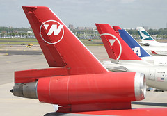 Northwest Old & New colours (JaffaPix .... +2.5 million views, thanks!) Tags: airplane airport nw northwest aircraft aviation aeroplane airline schipol ams nwa a330 airliner dc10 eham 25may05 amsterdamairport jaffapix davejefferys