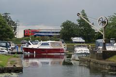 Ely (Neil Pulling) Tags: uk england marina train river riverside transport boating ely cambridgeshire thefens greatouse boatandtrain