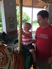 "Paul and Daddy on the Carousel at Brookfield Zoo • <a style=""font-size:0.8em;"" href=""http://www.flickr.com/photos/109120354@N07/19811599349/"" target=""_blank"">View on Flickr</a>"
