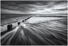 Tidal Motion.. (LoneWolfA7ii) Tags: bw black white sea water scotland aberdeen beach seaside seascape coast groyne sony a7ii waves monochrome mono sky clouds art light blackandwhite outdoor wave