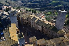 San Gimignano Piazza Cisterne (moniq84) Tags: san gimignano siena torre grossa tower piazza delle cisterne tetti towers colline tuscany toscana green roofs view countryside country fromthetop christmas time winter sunny day old houses buildings italia italy village borgo medieval hills trees wow landscape landscapes