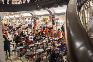 Anti-Torture Protesters March into the Food Court at Union Station