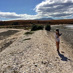 The Spit. Z carrying her driftwood finds, hoping for some Huon Pine (miaow) Tags: bellalunaboat tasmania summer2017 zoe beach 9yo