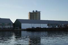 Reflections of a Shipyard (bMi2fotografx) Tags: green cover hold aluminum steel wood crowley reflection water industrial industry refurbish florida saintjohns river repair storage shipyard cargo transportation shipping