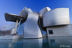 Guggenheim museum in Bilbao (Mimadeo) Tags: city travel blue sky urban reflection building art tourism metal museum architecture modern frank town spain colorful day view outdoor metallic contemporary steel famous landmark gehry bilbao spanish guggenheim titanium basque basquecountry ghery biscay