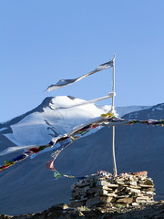 Stupa and Buddhist prayer flags on the wind against the  mountains and blue sky (straannick) Tags: panorama india lake mountains nature canon reflections landscape outdoors scenery colorful pastel religion praying scenic windy buddhism bluesky calm silence dreamy spirituality wilderness heavens picturesque mountainlake idyllic himalayas ladakh contemplation tsomoriri beautyinnature tibetanculture canonef70200mmf4lisusm canon7d mountainsreflectionsinthelake