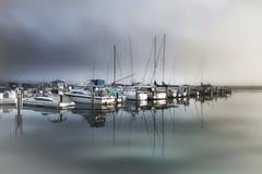 Port Washington Fog (tldoor) Tags: lake wisconsin sailboat port reflections sail