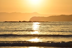 the sun sets... (JoannaRB2009) Tags: sunset sea water waves mediterranean light sun sunlight sunlit gold golden nature landscape seascape reflections hills island crete kriti kreta beauty beautiful greece greek summer beach hot sunsetbeach katodaratsos