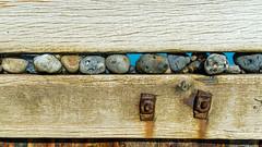 Salted Pebble sandwich.. (AJFpicturestore) Tags: pebbles stones sea seadefence fence fencefriday hff seawall norfolk westrunton