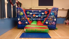 15x12 low height Celebration themed bouncy castle for indoors. £55 per hire.