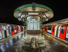 When one door is closed try the other one... (Aleem Yousaf) Tags: metro 16mm fisheye hainault central line station london undergrond benches train tube rail art deco reflections night city life dark tfl carriage shelter waiting room roof wall way out clocks commuters surreal