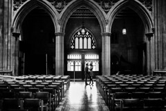 Brett and Heather in the Cathedral 4 B&W (Geoff Livingston) Tags: arch cathedral black white monochrome architecture couple love marriage engagement national public