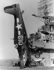 """Fighter F6F- 5 """" Hellket """" committed an emergency landing on the deck of the US aircraft carrier escort """" Takanis Bay """" circa 1945"""