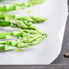 Asparagus with olive oil and garlic. (locrifa) Tags: new food green closeup season cuisine vegan spring healthy raw natural spears seasonal olive vegetable fresh gourmet clean asparagus meal vegetarian oil bunch organic diet preparation freshness nutrition ingredient