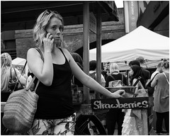 Strawberry girl (mesonparticle) Tags: bw woman london girl mobile lady strawberry phone market centre streetphotography cellphone strawberries southbank mobilephone fujifilm southbankcentremarket x100t topgunning
