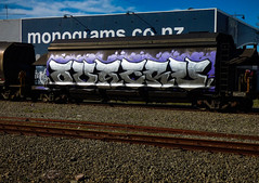 The Monogram (Steve Taylor (Photography)) Tags: monogram wagon tanker railway rail monograms art graffiti sign streetart tag blue mauve purple silver brown newzealand nz southisland canterbury christchurch city