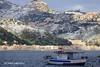This is Sicily _ Taormina: the beach and the snow (piero.mammino) Tags: sicilia sicily taormina naxos giardini castelmola spiaggia beach mare sea neve snow monti barca boat colline hills twop
