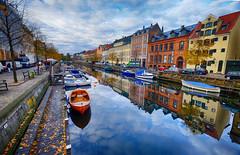 Canal at Christianhavn in Copenhagen, Denmark (` Toshio ') Tags: toshio copenhagen denmark europe european europeanunion canal townhouses water boat boats reflection christianhavn clouds fujixe2 xe2 danish scandinavia