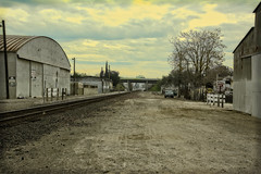 HEADED DOWNTOWN (akahawkeyefan) Tags: fresno davemeyer railroad tracks gravel sheds overpass