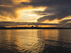 Shore to shore. (Pablin79) Tags: sky landscape reflections sunset water reflection nature river sun light clouds outdoor summer plants silhouette evening calm shore shadows dawn cloud dusk afternoon argentina goldenhour misiones posadas