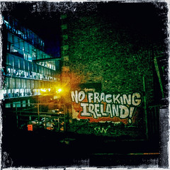 No Fracking Ireland! (soilse) Tags: city bridge ireland dublin night train buildings painting lights graffiti artwork darkness artistic platform officebuilding trains railwaystation oil brightlights lettering offices resources tallbuilding paintedwall iphone 2014 dublincity grandcanaldock oilexploration googlebuilding fracking iphonecamera hipstamatic hipstamaticapp hipstamaticcamera nofracking oiltar october2014 nofrackingireland oiltarfracking