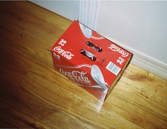 Box of Coca-Cola cans (Matthew Paul Argall) Tags: box 110 coke packaging cocacola 110film