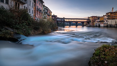 Ponte degli Alpini at sunrise - Bassano del Grappa, Italy - Travel photography (Giuseppe Milo (www.pixael.com)) Tags: grass calm print nature water bassano italia orange morning outside photography sky bridge river wallart italy horizontal fineart pontedeglialpini tranquil prints landscape winter bassanodelgrappa old european ponte photo outdoor landscapes cityscape wood waves bluesky sun blue photograph vecchio beautiful travel canvas sunrise peaceful alpini green scenic europe depth yellow onsale