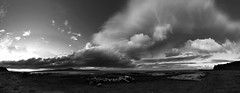 as a storm rages over North Iceland (lunaryuna) Tags: iceland northiceland coast coastline sea shore shoreline bay driftwood panorama stitchedpanorama sky clouds cloudscape storm stormclouds lightmood sunset sundown nightfall lunaryuna landscape seascape blackwhite bw monochrome