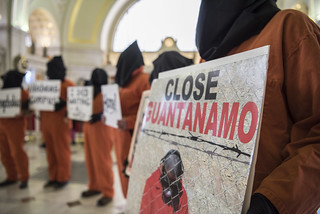 "A Protester Holds a ""Close Guantánamo"" Sign at an Anti-Torture Demonstration in Union Station"