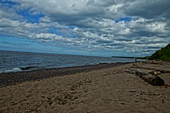 Calm Day On The Beach (chumlee10) Tags: lakesuperior beach michigan upperpeninsula surf waves rocks sand clouds up driftwood
