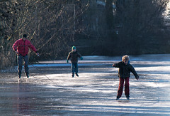 Look daddy, I can do it . . (Eduard van Bergen) Tags: pond winter water ice frozen frost canal bosom boezem circles open sun light bush wind cold outdoor molens mills moulin mühle miller molenaar reed riet wideness wijdte ijs landscape field dike polder skating skates trees panorama sloot ditch skater boys girls bridge fun plezier molenwaard alblasserwaard liesveld holland netherlands niederlande dutch pays bas nederland rural farming farmer grass cloth clothing mother father children learning education daddy mom young pleasure hubbie delight classic first