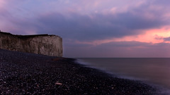 and you hear nothing else but the Sea (lunaryuna) Tags: england eastsussex southdownsnationalpark sevensisters sea coastl beach pebblebeach chalkcliffs nightfall dusk afterglow sky clouds sunset sundown lightmood landscape seascape coastline shore colours winter season seasonalbeauty le longexposure lunaryuna