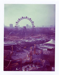From one ferris wheel to another (George Pollard) Tags: vienna wien city holiday polaroid austria cityscape view fairground 2006 ferriswheel instant amusementpark february expired funfair prater 669 outofdate instant30