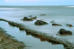 Calm and calmer (Ray Byrne) Tags: uk england beach water canon 350d coast rocks pavement north northumberland shore alnmouth northern northeast raybyrne judgementday57 judgmentday57 byrneout