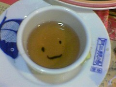 Smiling Tea (Kam) Tags: cameraphone cup smile face smiling mobile phone tea snap chinesetea