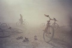 dust storm (lomokev) Tags: storm bike canon sand bikes burningman blackrockcity cycle dust duststorm fahrrad vlo fiets eos1 blackrock bicicletta burningman2005 bicis blackrocksands rota:type=landscape rota:type=showall rota:type=accessories  file:name=bm2005llomo11 roll:name=bm2005llomo