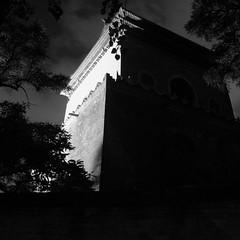 The Bell Tower in B & W (Snow Kisses Sky) Tags: 2005 china longexposure shadow bw tree architecture nikon october tripod beijing highcontrast belltower nightlight nightscene nikkor