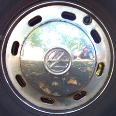 VW Beatle wheel (Bobby8) Tags: reflection car wheel topv111 metal vw bug volkswagen topv555 topv333 beatle squaredcircle squircle kodakdx4530