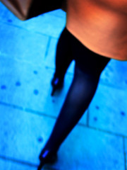 Blue legs orange dress (ale2000) Tags: street blue people orange woman black blur color colour feet girl digital walking back interestingness shoes colore action pavement walk fake run skirt bathed frombeh