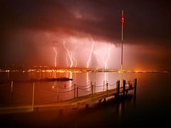 Take THAT, France (-Antoine-) Tags: longexposure red lake storm france nature night clouds rouge switzerland interesting power suisse geneva flag topv1111 topc50 lac quay thunderstorm lightning evian svizzera nuages leman lman topf100 nuit quai thunder ec