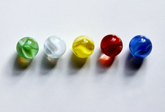 5 Marbles 5 Colors (Andrew Morrell Photography) Tags: blue red white green glass colors yellow shiny colorful clear round marbles whiteground catchycolorsrainbow ccpb0609