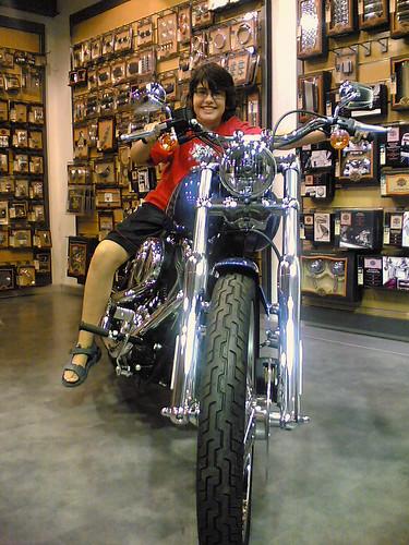 Arif astride a Harley Davidson motorcycle