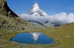 Matterhorn above riffelsee (Ron Layters) Tags: mountains slidefilmthenscanned slide transparency rescanned matterhorn riffelsee zermatt valais wallis switzerland reflection clouds geo:lat=459835 geo:lon=776287 flickrfly geotagged ronlayters montcervin cervin explore interestingness nature cervino 4478m 14692ft summitmatterhorn altitude4478m elevation40004500m mountainsalps highestpositioninexplore110onsundayoctober192008