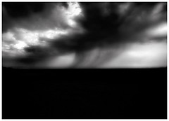 Falling (Jeff T. Alu) Tags: digital black white photoshop rain storm desert clouds surreal moody lonely dark outdoors bleak blackandwhite deserted illusion zen medetation medetate power impact graphic doom bright earthy dirt gritty intense visionary heat passion 4x4 remote california desolate dreamy nightmare euphoric