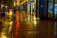 here comes the wet season (fotogail) Tags: show sanfrancisco street winter red urban favorite reflection brick wet rain yellow night wow catchycolors dark walking gold lights reflex interesting downtown bright pavement walk bricks fv5 nighttime walker rainy bayarea popular walkers liquid puc fotogail wetpavement bapfs top2005 sfchronicle96hours your300pre2006favesthanks printforpucshow artonthewallsatthecaliforniapuc thebestyellow