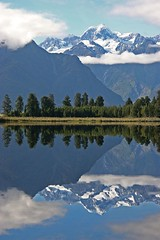 Mountain Cook (!.Keesssss.!) Tags: newzealand cloud lake reflection tree nature vertical landscape outdoors photography day nopeople symmetry snowcapped mtcook scenics gettyimages lakematheson tranquilscene traveldestinations beautyinnature rightsmanaged theflickrcollection keessmans sales200906 gettysales kssoldonetime 002ksgetty