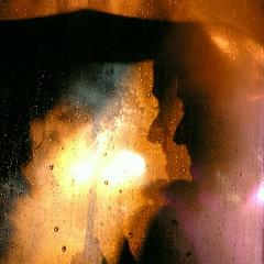 Smoke Break (Linus Gelber) Tags: nyc light newyork abstract window glass rain umbrella drops citylife smoking moisture rockwoodmusichall tccomp034 utataabstract