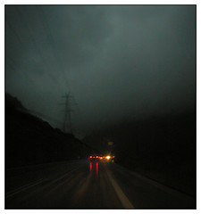 Rainy road (elpen) Tags: night road cables cars lights darksky nikoncp8400 wet rain